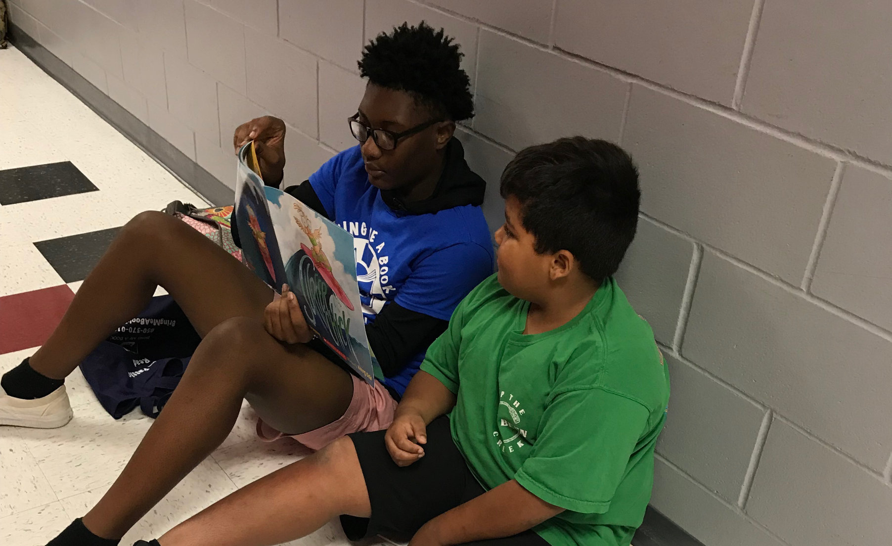 2 students reading to one another