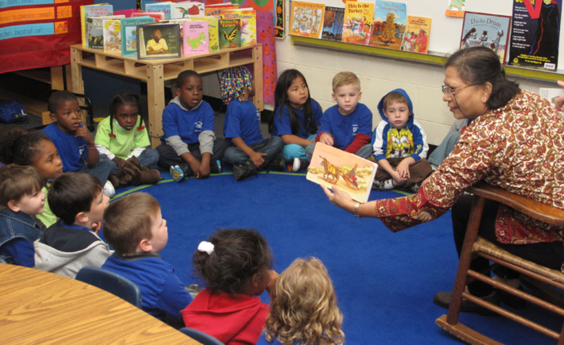 Woman reading to pre-k class