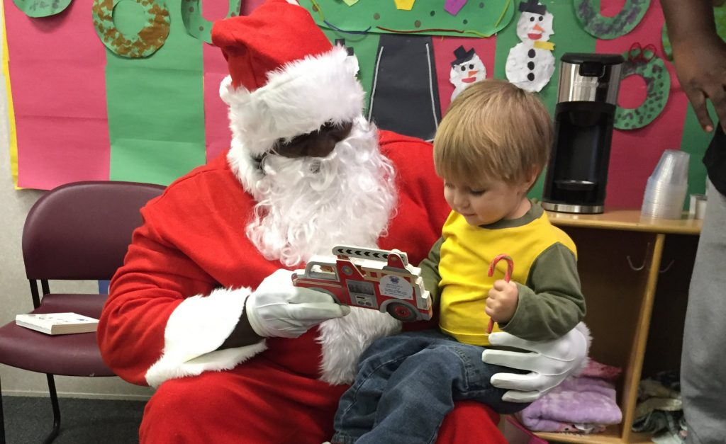 Early headstart child sitting on Santa's lap