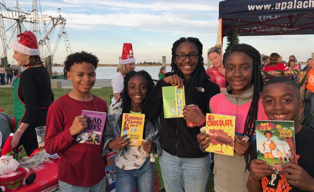 Jasmine's kids holding books